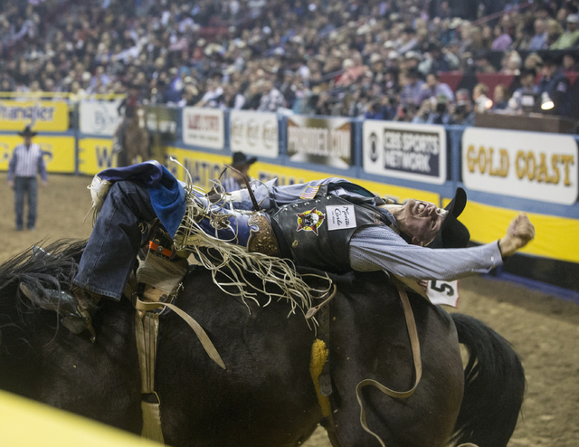 Orin Larsen rides Full Baggage during the bareback riding competition at the National Finals Rodeo at the Thomas & Mack Center on Thursday, Dec. 8, 2016, in Las Vegas. (Benjamin Hager/Las Vega ...