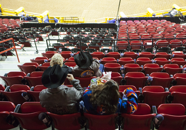 Attendees wait in their during the fourth day of the National Finals Rodeo at the Thomas & Mack Center in Las Vegas on Friday, Dec. 4, 2016. (Miranda Alam/Las Vegas Review-Journal) @miranda_alam