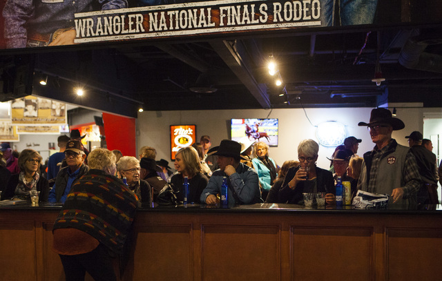 Attendees sit at a bar during the fourth day of the National Finals Rodeo at the Thomas & Mack Center in Las Vegas on Friday, Dec. 4, 2016. (Miranda Alam/Las Vegas Review-Journal) @miranda_alam