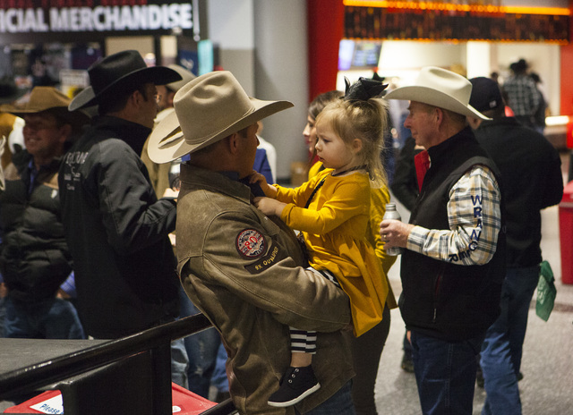Attendees wait on the concourse during the fourth day of the National Finals Rodeo at the Thomas & Mack Center in Las Vegas on Friday, Dec. 4, 2016. (Miranda Alam/Las Vegas Review-Journal) @mi ...