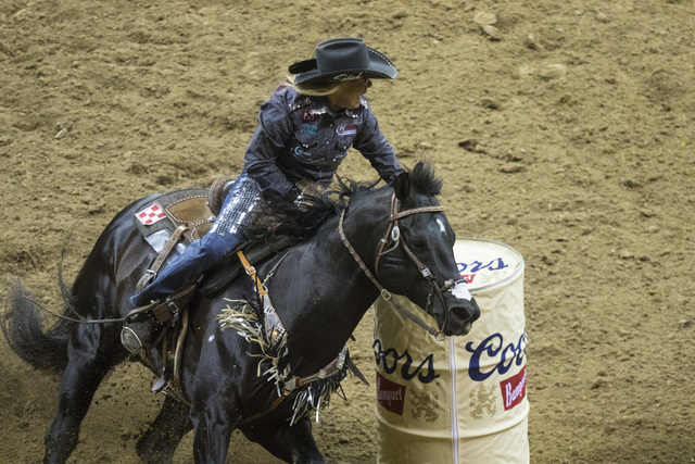 Michele McLeod competes in the barrel racing event during the fourth day of the National Finals Rodeo at the Thomas & Mack Center in Las Vegas on Friday, Dec. 4, 2016. (Miranda Alam/Las Vegas  ...
