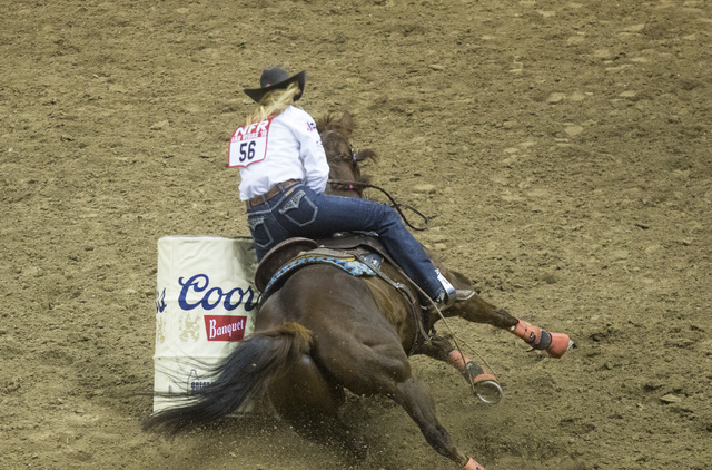 Sherry Cervi knocks a barrel over during the barrel racing event at the fourth day of the National Finals Rodeo at the Thomas & Mack Center in Las Vegas on Friday, Dec. 4, 2016. (Miranda Alam/ ...