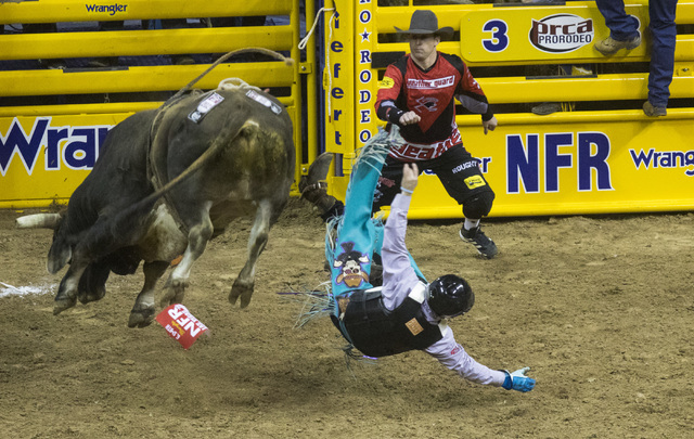 Garrett Smith is thrown from his bull during the bull riding event at the fourth day of the National Finals Rodeo at the Thomas & Mack Center in Las Vegas on Friday, Dec. 4, 2016. (Miranda Ala ...