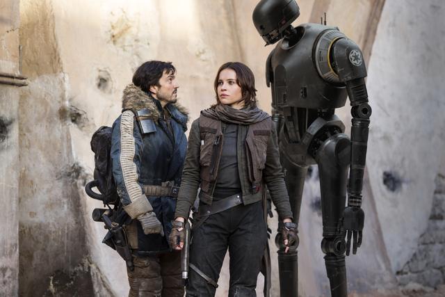 "Cassian Andor (Diego Luna), left, Jyn Erso (Felicity Jones) and K-2SO (Alan Tudyk) star in ""Rogue One: A Star Wars Story."" (Jonathan Olley/Lucasfilm Ltd.)"