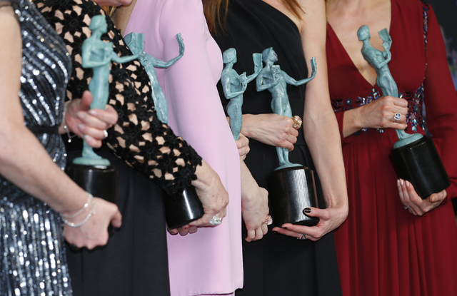 "Actresses (from left) Phyllis Logan, Raquel Cassidy, Lesley Nicol, Sophie McShera and Joanne Froggatt of ""Downton Abbey"" hold their awards for Outstanding Performance by an Ensemble in a Drama Ser ..."