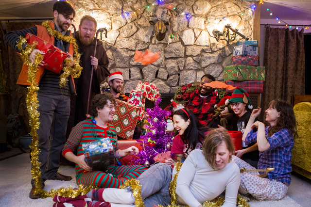 """The local Las Vegas indie band Same Sex Mary poses for a photo with cast members for """"A Very Merry Same Sex Mary Christmas Spectacular"""" in a band member's home in Las Vegas, Thursday, Dec. 15, 201 ..."""