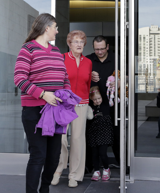 Michael Sandford's mother Lynne Sandford, left, his grandmother Christine, his sister Jessica, 4, and his father Paul Davey, right, leave the Lloyd George Federal Courthouse in Las Vegas Tuesday,  ...