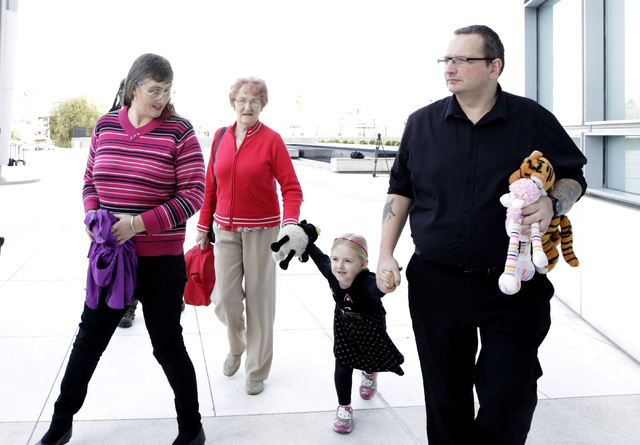 Michael Sandford's mother Lynne Sandford, left, his grandmother Christine, his sister Jessica, 4, and his father Paul Davey leave the Lloyd George Federal Courthouse in Las Vegas Tuesday, Dec. 13, ...
