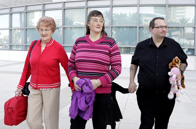 Michael Sandford's grandmother Christine Sanford, left, his mother Lynne, his sister Jessica, 4, and his father Paul Davey leave the Lloyd George Federal Courthouse in Las Vegas Tuesday, Dec. 13,  ...