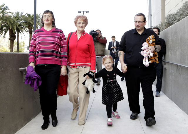 Michael Sandford's mother, Lynne Sandford, left, his grandmother Christine, his sister Jessica, 4, and his father Paul Davey leave the Lloyd George Federal Courthouse in Las Vegas Tuesday, Dec. 13 ...