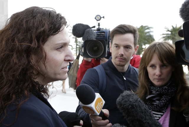 Michael Sandford's attorney, Brenda Weksler, addresses the media outside the Lloyd George Federal Courthouse in Las Vegas Tuesday, Dec. 13, 2016. Sandford, who attempt to kill Donald Trump is sent ...