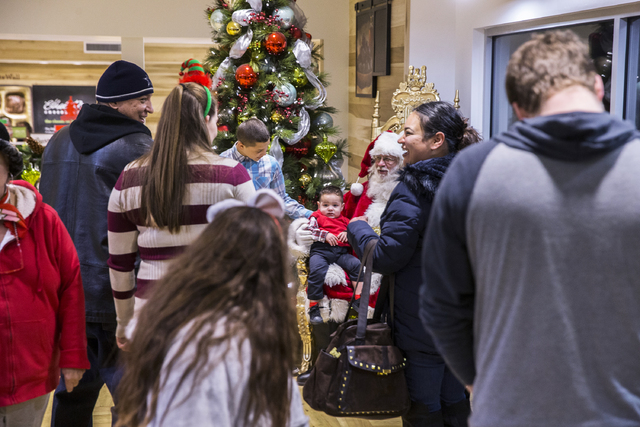 "Santa Claus Barry Solomon interacts with guests at the Ethel M Chocolate Factory on Friday, Dec. 16, 2016, in Henderson. ""I want to give the spirit of giving and joy in every way I can,"" said Solo ..."