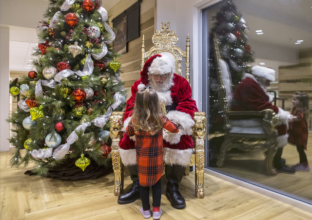 "Santa Claus Barry Solomon greets Joanna Fountain, 2, at the Ethel M Chocolate Factory on Friday, Dec. 16, 2016, in Henderson. ""I just love it,"" said Solomon. ""It's the most rewarding experience of ..."