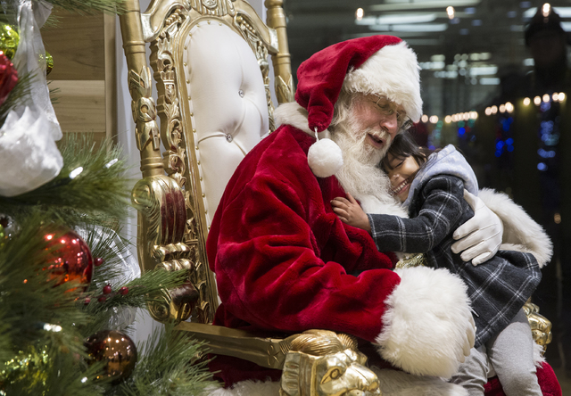 "Santa Claus Barry Solomon, left, gets a big hug from Katelyn Mahe, 4, at the Ethel M Chocolate Factory on Friday, Dec. 16, 2016, in Henderson. ""I love their hugs,"" said Solomon. ""It's just so rewa ..."