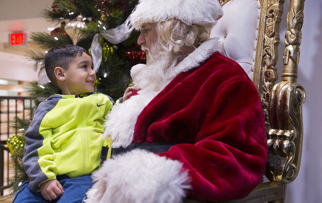 "Santa Claus Barry Solomon, right, talks with Adrian Martinez at the Ethel M Chocolate Factory on Friday, Dec. 16, 2016, in Henderson. ""If I could be here every day, all day and all night, I would  ..."