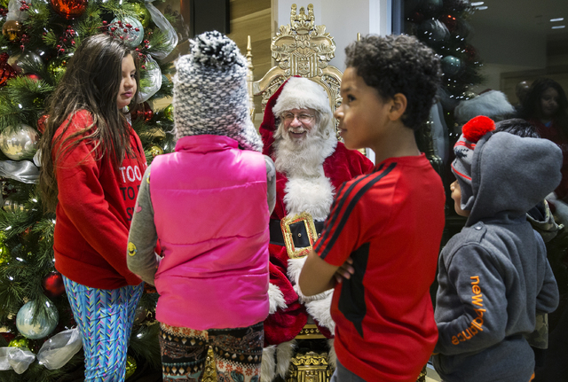 "Santa Claus Barry Solomon listens to children's Christmas lists at the Ethel M Chocolate Factory on Friday, Dec. 16, 2016, in Henderson. ""I want to give the spirit of giving and joy in ev ..."