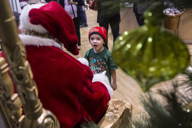 "Elijah Ortega, 3, says hello to Santa Claus Barry Solomon  at the Ethel M Chocolate Factory on Friday, Dec. 16, 2016, in Henderson. ""If I could be here every day, all day and all night, I would do ..."