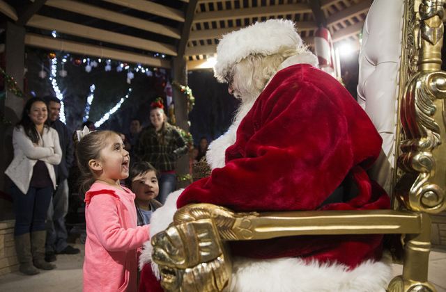 "Santa Claus Barry Solomon, right, greets Bella Delariva at the Botanical Cactus Garden at the Ethel M Chocolate Factory on Saturday, Dec. 17, 2016, in Henderson. ""It's the most rewarding experienc ..."