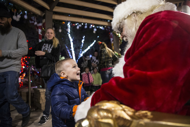 "Santa Claus Barry Solomon, right, greets Junior David Lopez at the Botanical Cactus Garden at the Ethel M Chocolate Factory on Saturday, Dec. 17, 2016, in Henderson. ""It's the most rewarding exper ..."