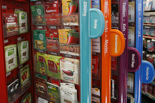 FILE- This Dec. 22, 2009, file photo shows a gift card kiosk in New York. If you know you won't be using a gift card, you can sell them at a number of sites, including CardCash, Cardpool an ...