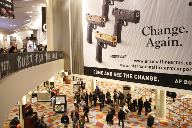 People walk in the Sands Expo Convention Center during the annual Shooting, Hunting and Outdoors Trade Show Tuesday, Jan. 20, 2015. (Erik Verduzco/Las Vegas Review-Journal)