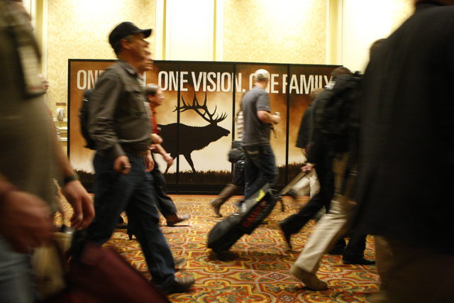 People walk through the annual Shooting, Hunting and Outdoors Trade Show Tuesday, Jan. 20, 2015, at the Sands Expo Convention Center. (Erik Verduzco/Las Vegas Review-Journal)
