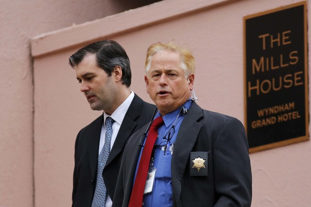 Michael Slager, left, walks from The Mills House Hotel to the Charleston County Courthouse under the protection from the Charleston County Sheriff's Department during a break in the jury deliberat ...