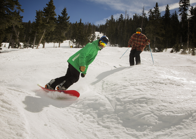 Marco Sanchez of Gilbert, Arizona, and Scott Cumberland of Anchorage, Alaska, try the moguls  at Arizona Snowbowl on March 5, 2016. The resort, just outside of Flagstaff, has been in operation sin ...
