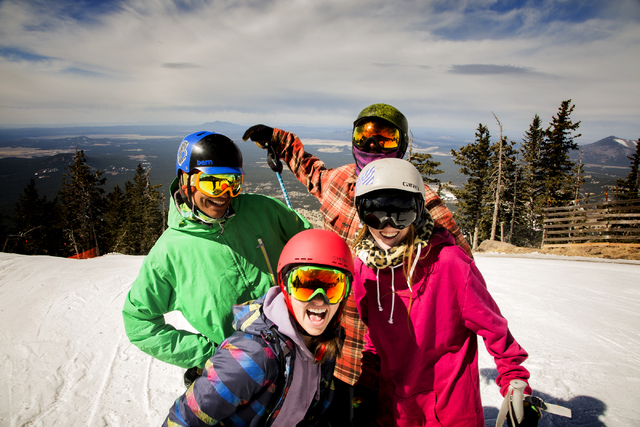 Clockwise from top right, Scott Cumberland, Heather Cason, Rylie Backus and Marco Sanchez pose for a photo on the slopes of Arizona Snowbowl on March 5, 2016. The resort, just outside of Flagstaff ...