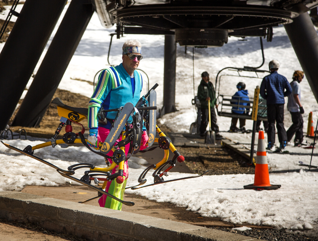 A man carries ski trikes at Arizona Snowball on March 5, 2016. The resort is just outside of Flagstaff and has been in operation since 1938, making it one of the longest continually running ski re ...