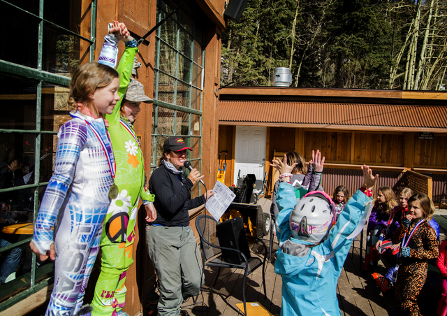 Young skiers cheer during a ski medal ceremony at Arizona Snowbowl on March 5, 2016. The resort is just outside of Flagstaff and has been in operation since 1938, making it one of the longest cont ...