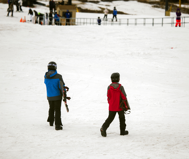 Young skiers head to a lift at Arizona Snowbowl on March 6, 2016. The resort is just outside of Flagstaff and has been in operation since 1938, making it one of the longest continually running ski ...