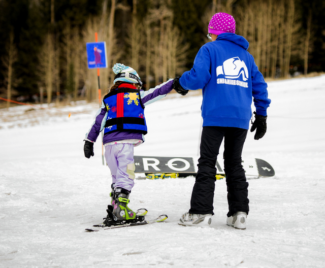 An instructor helps a young skier at Arizona Snowbowl on March 6, 2016. The resort is just outside of Flagstaff and has been in operation since 1938, making it one of the longest continually runni ...