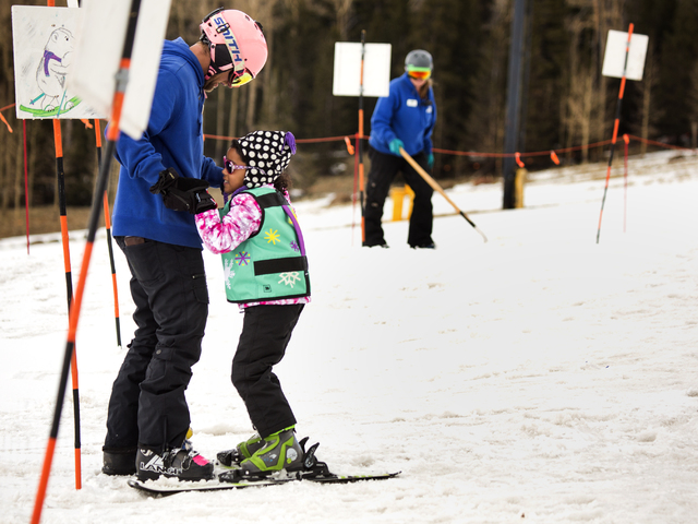 An instructor helps a young skier at Arizona Snowbowl on March 6, 2016. The resort is just outside of Flagstaff, has been in operation since 1938, making it one of the longest continually running  ...