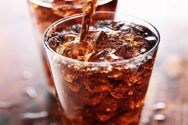 Soft drink being poured into glass. (Thinkstock)