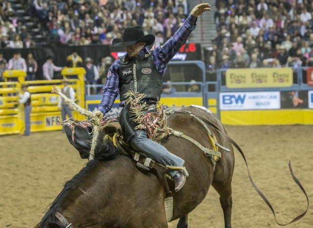 Jacobs Crawley competes in the saddle bronc riding competition during the National Finals Rodeo at the Thomas & Mack Center on Monday, Dec. 5, 2016, in Las Vegas. Benjamin Hager/Las Vegas Revi ...