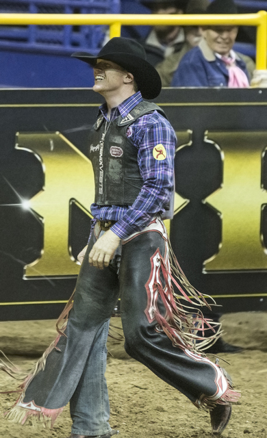Jacobs Crawley celebrates after a run in the saddle bronc riding competition during the National Finals Rodeo at the Thomas & Mack Center on Monday, Dec. 5, 2016, in Las Vegas. Benjamin Hager/ ...