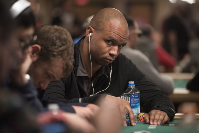 Professional poker player Phil Ivey plays in a hand during the Main Event of the World Series of Poker at the Rio Convention Center in Las Vegas on Monday, July 11, 2016. (Martin S. Fuentes/LasVeg ...
