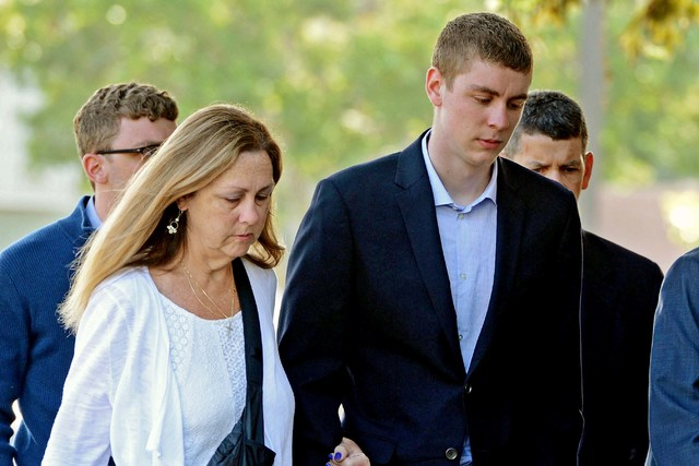 Brock Turner, right, makes his way into the Santa Clara Superior Courthouse in Palo Alto, Calif., June 2, 2016. A letter written by Turner's father was made public over the weekend by a Stanford l ...