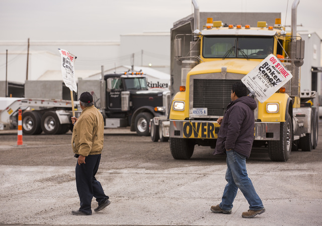 A semi-truck loaded with concrete conduit waits while Teamsters Local 631 walk the picket line in front of Rinker Hydro Conduit, 2100 Burns Ave., in Henderson on Wednesday, Dec. 21, 2016. Jeff Sch ...