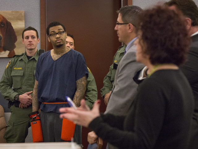 Self-proclaimed pimp Ammar Harris listens while prosecutor Lisa Luzaich, right, speaks during his sentencing on rape and robbery convictions in Clark County District Court. (Jeff Scheid/Las Vegas  ...