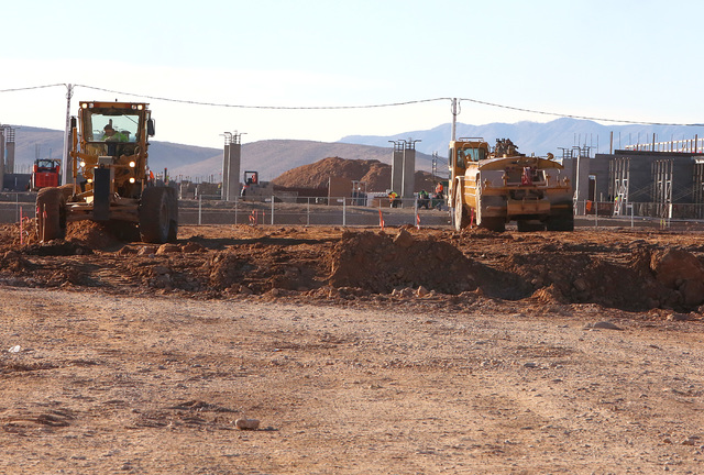 Heavy-duty, earth-moving equipment at the site at the site where Summerlin developer Howard Hughes Corp. has plans to build an office tower next to the new NHL practice rink in Summerlin on Tuesda ...