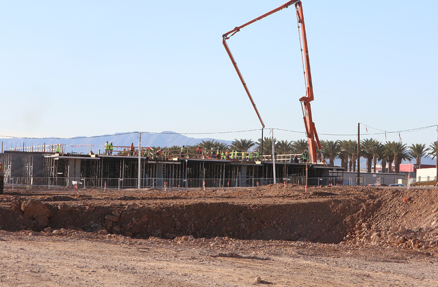 Construction workers at the new NHL practice rink, near the site where Summerlin developer Howard Hughes Corp. has plans to build an office tower next to in Summerlin on Tuesday, Dec. 20, 2016. (B ...