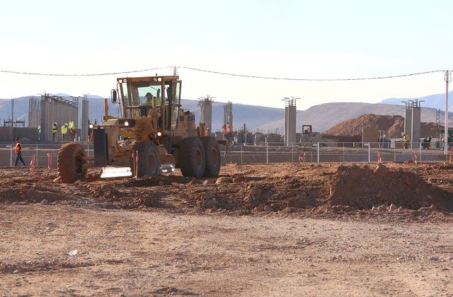 Heavy-duty, earth-moving equipment at the siteat the site where Summerlin developer Howard Hughes Corp. has plans to build an office tower next to the new NHL practice rink in Summerlin on Tuesday ...