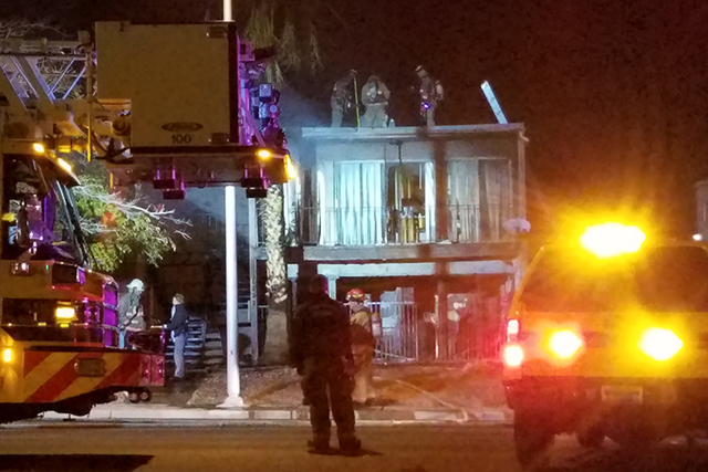 An apartment fire at 1332 E. Desert Inn Road displaced 10 people. No one was injured although some children trapped on a second-floor balcony were dropped over the side to safety. (Mike Shoro/Las  ...