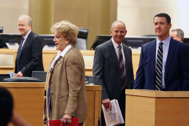 Las Vegas Mayor Carolyn Goodman, arrives at the council chambers with Pat Egan, NV Energy senior vice president of customer operations, right, and Tom Perrigo, planning director and chief sustaina ...