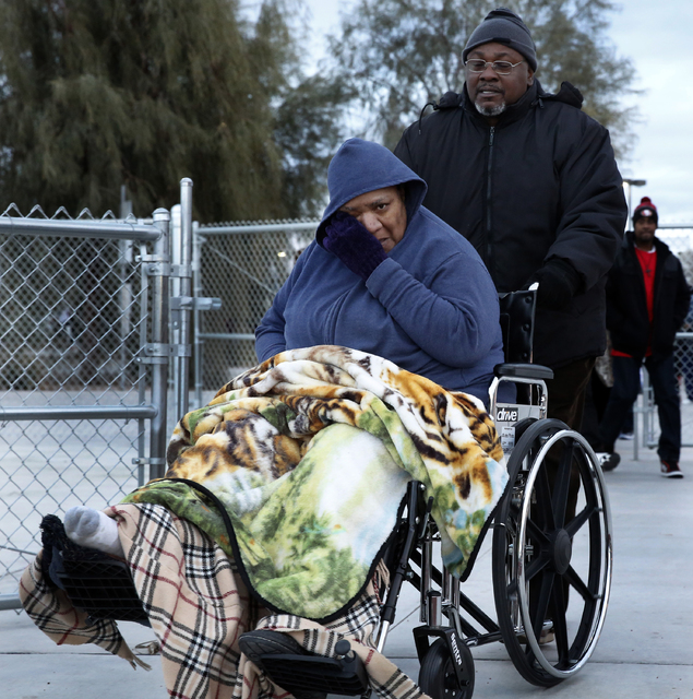 Stephanie Weatherspoon and her husband, Michael, arrive at a vigil for Jesse Lee Swan at Dr. William U. Pearson Community Center, Dec. 24, 2016 in North Las Vegas. Stephanie is the stepmother of S ...