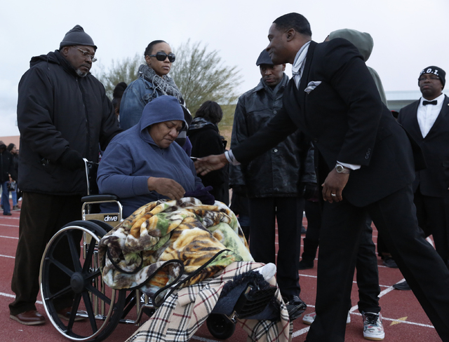 Stephanie Weatherspoon is comforted by a guest at a vigil for Jesse Lee Swan at Dr. William U. Pearson Community Center, Dec. 24, 2016 in North Las Vegas. Stephanie is the stepmother of Swan. (Dav ...