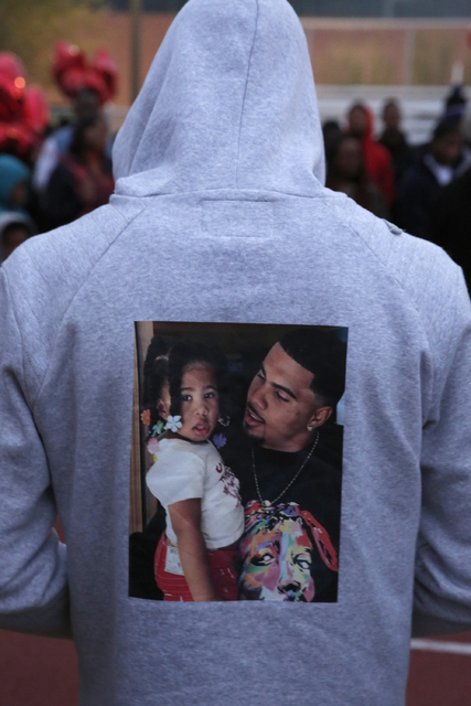 A guest wears a sweater with a photo of Jesse Lee Swan, right, during Swan's vigil at Dr. William U. Pearson Community Center, Dec. 24, 2016 in North Las Vegas. (David Guzman/Las Vegas Review-Jour ...