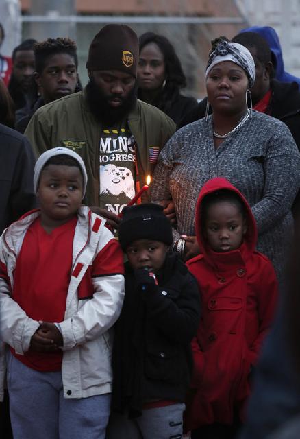 Guests attend a vigil for Jesse Lee Swan at Dr. William U. Pearson Community Center, Dec. 24, 2016 in North Las Vegas. (David Guzman/Las Vegas Review-Journal) @DavidGuzman1985